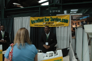 Exhibitors of Greenfleet Car Service promote their fleet of hybrid vehicles at the Global Green Expo.