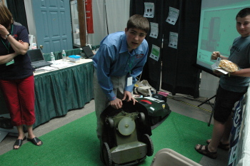 An exhibitor shows the Husqvarna Automower