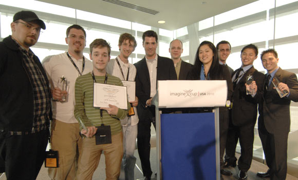 US Imagine Cup winners pose with Microsoft executives. Best Game software winners on left; Grand Prize winners on right: Microsoft