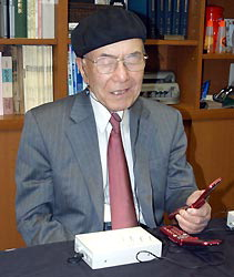 Hasegawa with Braille cell phone