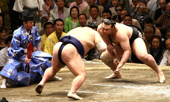 Kotooshu (right) charges his opponent on the final day of the 2008 Spring Sumo Tournament in Tokyo