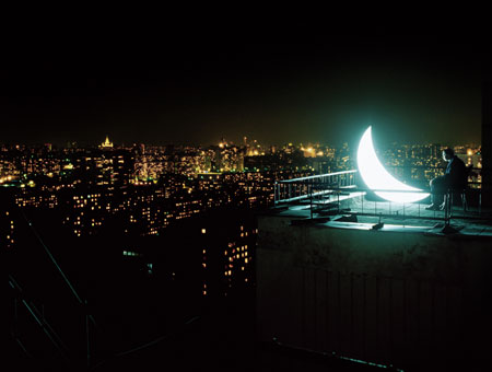 The Moscow Moon/ in a starless sky/ has sat down on the edge of a roof