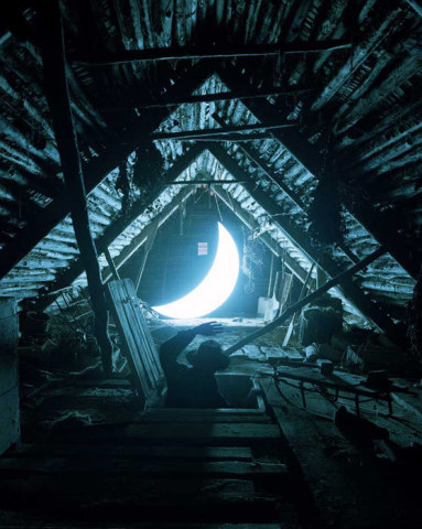 The sky is near. /Open the attic and you'll see/ there next to the wasp nest/ rings the blinding light/of the lost moon