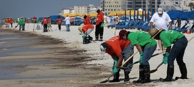 Oil cleanup workers at Orange Beach, Ala.: Photo: Dave Martin, Associated Press, via WOAI.com