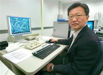 Ben Wang, director of Florida State's High-performance Materials Institute, with a computer screen showing a microscopic view of buckypaper. Credit: AP Photo/Phil Coale.