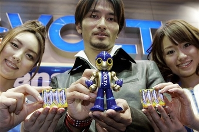 EVOLTA robot, held by Japanese robot designer Tomotake Takahashi