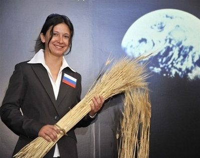 "A Russian lab student from Okayama University shows off the latest crop of ""space barley"""