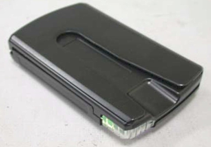 Insert an ATM/credit card into the back of the device