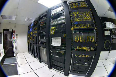 Telecommunications equipment in one corner of a small data center.: Credit: Gregory Maxwell.