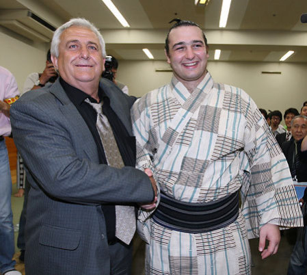 Proud Papa congratulates Kotooshu on his day of triumph