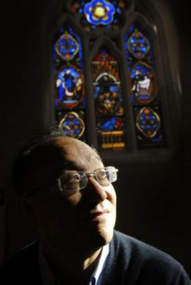 Associate Professor Zhu Huai Yong, from Queensland University of Technology's School of Physical and Chemical Sciences, said that church windows stained with gold paint purify the air when they are lit up by sunlight. Credit: QUT: Erika Fish
