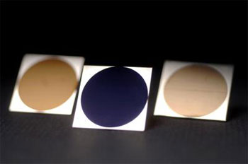 (From left) Gold aluminum, blue titanium, and gold platinum.: Credit: Richard Baker, University of Rochester