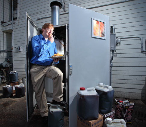 James Peret, PopSci Invention Winner 2009, stands on his Vegawatt
