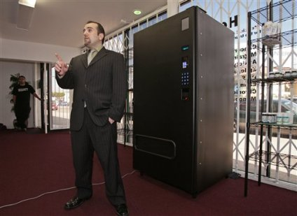 Owner Vincent Mehdizadeh with vending machine: Image: KansasCity.com