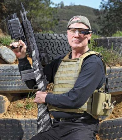 SmartSight outfitted rifle, inventor Matthew Hagerty: Photo: John B. Carnett, image via PopSci.com